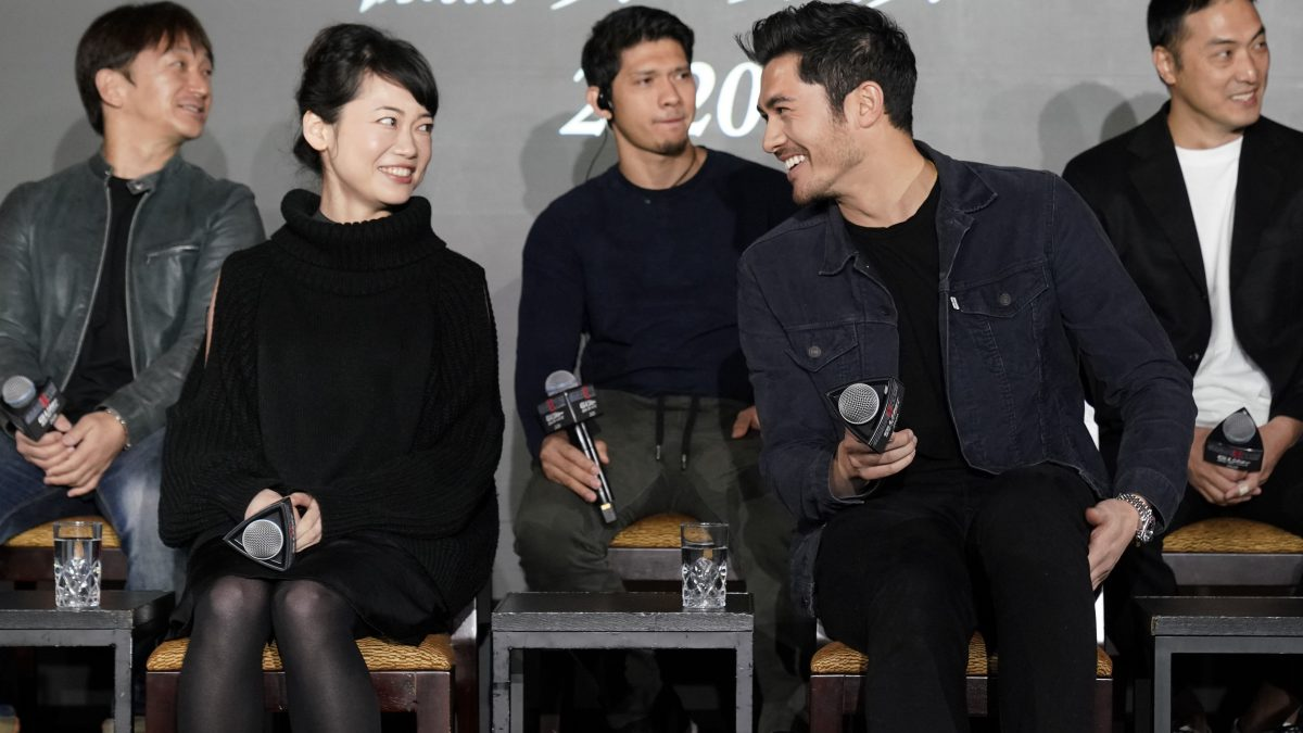 TOKYO, JAPAN - JANUARY 10: (L) Haruka Abe and (R) Henry Golding attend the
